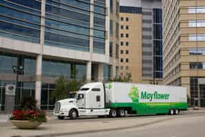 Commercial Movers parked outside of office building