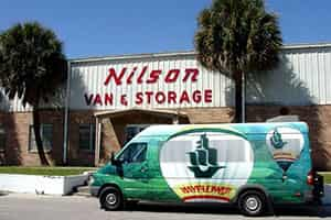 Nilson Van Building with moving truck outside